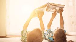 kids-on-floor-in-sun-250x139