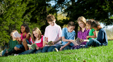 kids-on-hill-reading-small-250x139